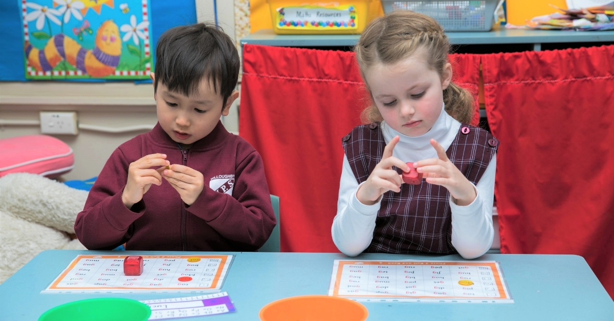 Children hands on learning in classroom
